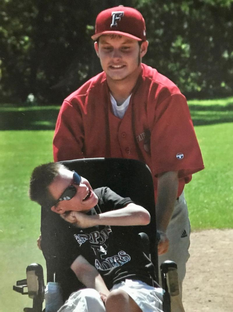 "James takes his brother, Jonathan, around the bases at one of James' baseball games. ""You see the joy in both faces,"" Barbara says."