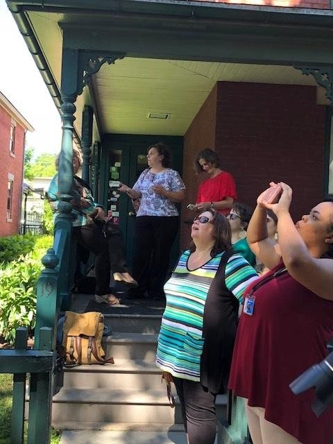Staff members of the Susan B. Anthony House and Museum watch removal of historic tree