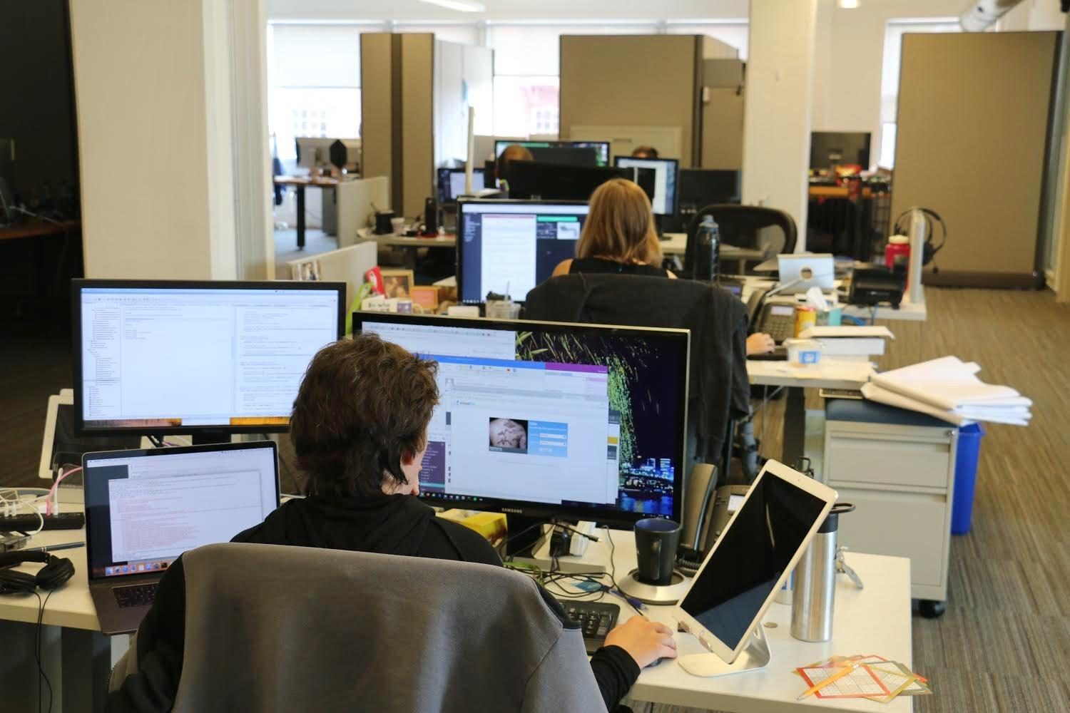 Row Of Software Engineers At Visualdxs Office In Rochester The Company Is Shifting Its Focus To Machine Learning Ceo Art Papier Says