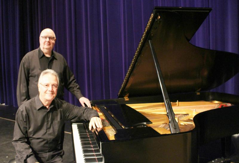 Pianists Michael Landrum and Joe Werner next to a piano