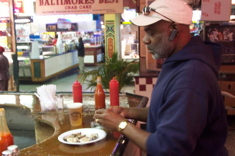 Pete Murphy of Prince George's County fixes clams at Faidley's.