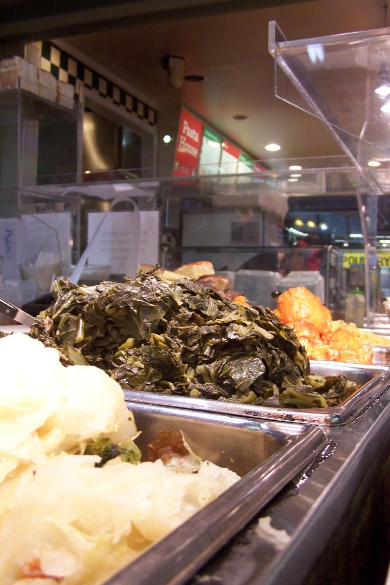 Mashed potatoes and collard greens for sale.