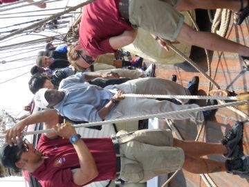 Zion Shaw raises a sail.