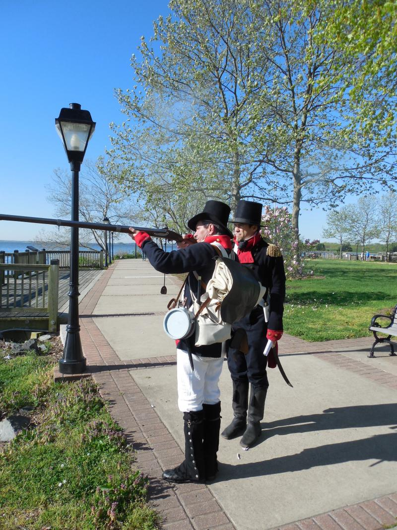 Tim Ertel (left) and Vince Vaise, rangers at Fort McHenry, drum up interest in this weekend's War of 1812 celebration in Havre de Grace.