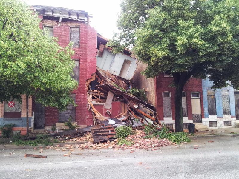 A row house in the 400 block of East Biddle Street collapsed on June 7, prompting concern among neighbors.