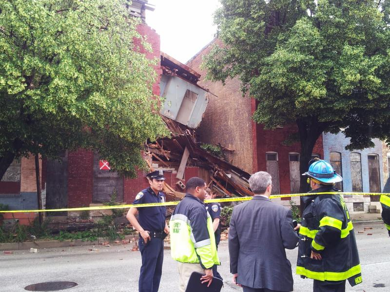 No one was hurt in the row house collapse. The house was empty for quite sometime.