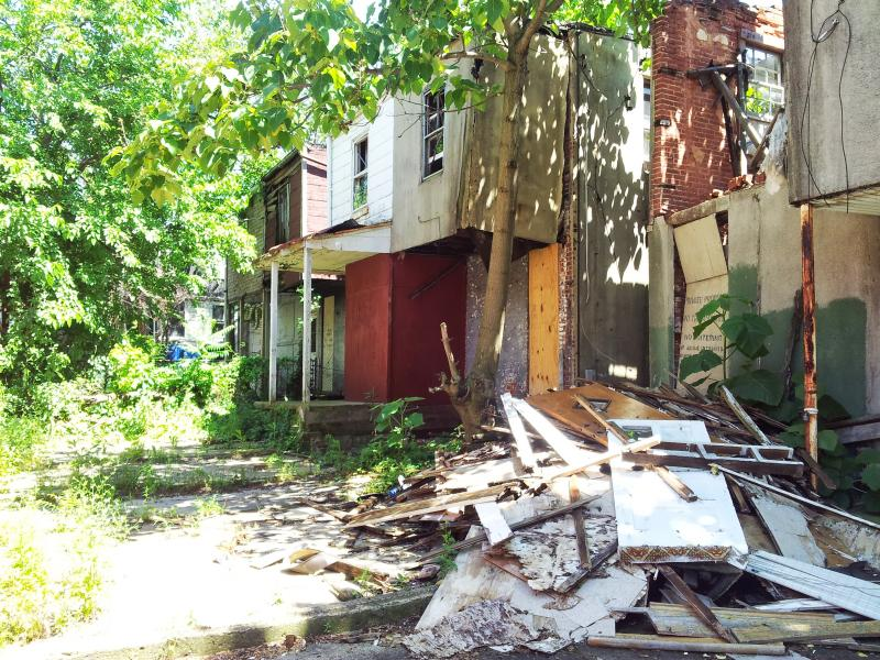 The back portions of two of the properties in the 1100 block of East Hoffman Street have collapsed. Clara Bailey, whose family are the only occpuants on the block, said they have not had neighbors in over 20 years.