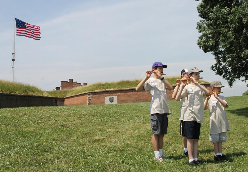 The Great Garrison Flag flies in the background at Fort McHenry.
