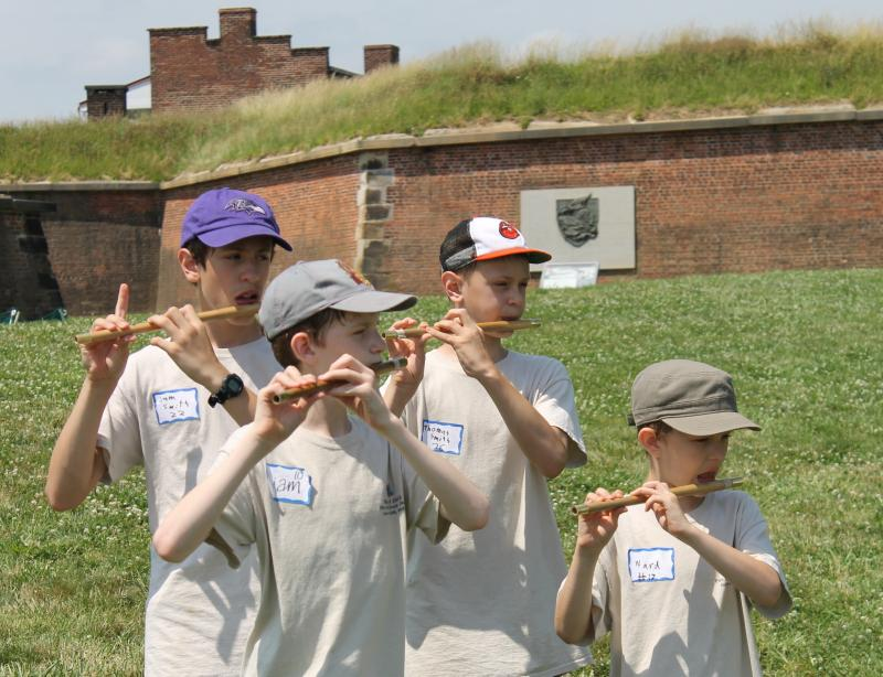 (Clockwise from front left) Liam Lewis, Sam Smith, Thomas Smith and Ward Lewis practice playing their fifes in formation at Fort McHenry in Baltimore on June 27, 2013.