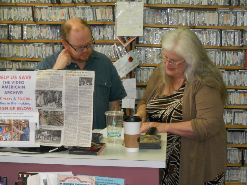Store manager Scott Brown and co-owner Annie Solan, working behind the counter at Video Americain in Roland Park.
