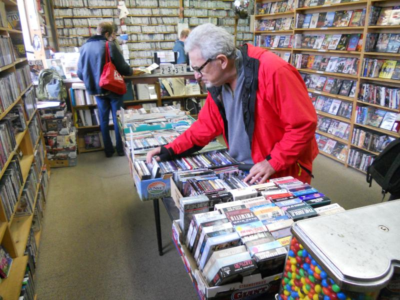 Video Americain customer Jeffrey Kliman looking for a good movie to rent.