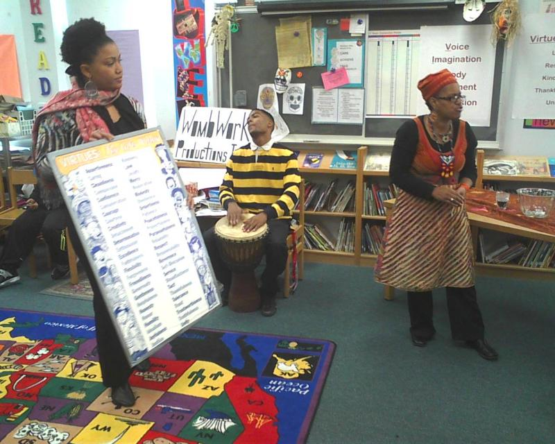 Members of WombWork teach a lesson. The students sang, danced, clapped and acted as a way to learn vocabulary.