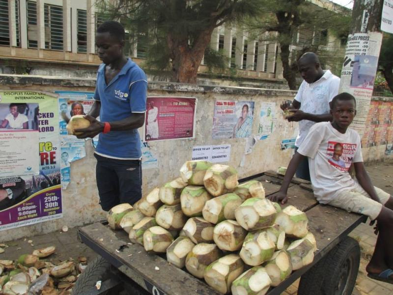 Stands like this one, where families sell coconuts and other vegetables, are a common site in Accra, Ghana. Some students miss school because they have to help their parents out in their stands or in the large marketplaces.