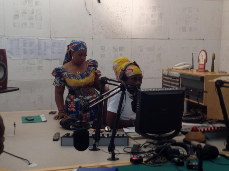 Ghana Broadcasting Corporation radio news anchor Marie Aziz Tunde, left, and her colleague, talk show host Kwame. Aziz Tunde says economics is a major reason students miss school a lot in Ghana.