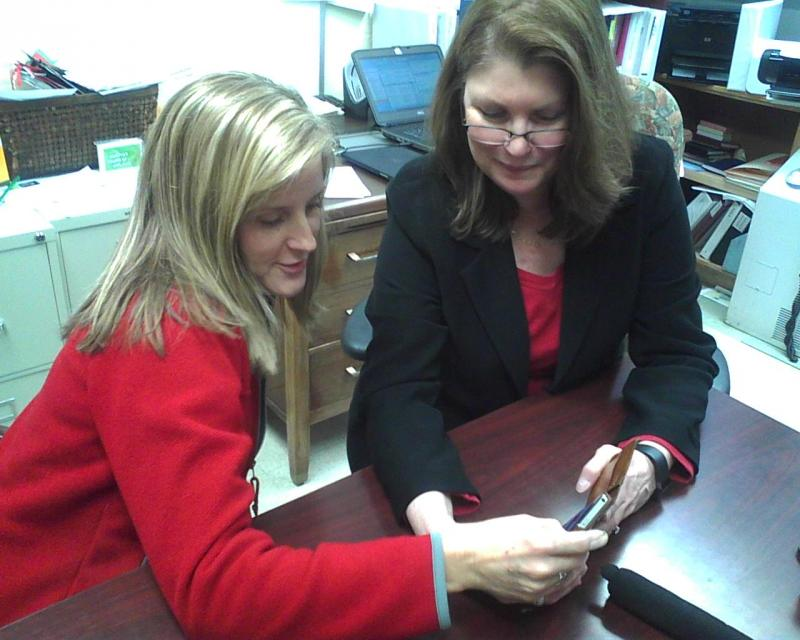 Ridgely Middle counselor Jill Jahries (l) and principal Sue Evans read kindly-worded tweets from eighth-graders.