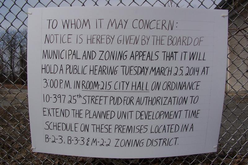 On a recent Saturday, this sign is posted on a fence on 24th Street, notifying neighborhoods of an upcoming hearing at the Board of Municipal and Zoning Appeals.