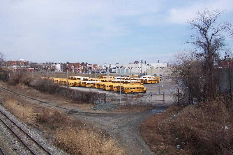 Busses now occupy part of the 11.5 acre development site