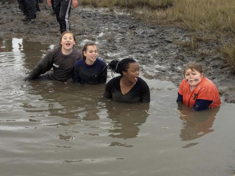Students go marsh mucking. From left: Annsley Puch, Alex English, Nija Hunter and Rachel Jackson.