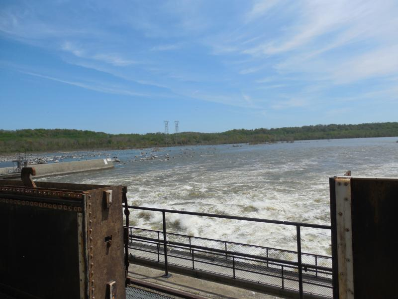 A view downriver from a deck part way up the wall of the dam.