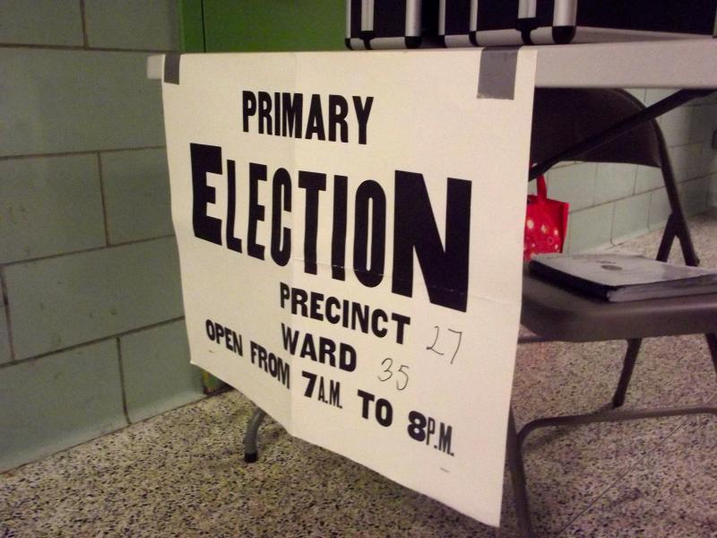 Signs were put up in front of tables to help voters find their designated voting area at the Baltimore IT Academy.