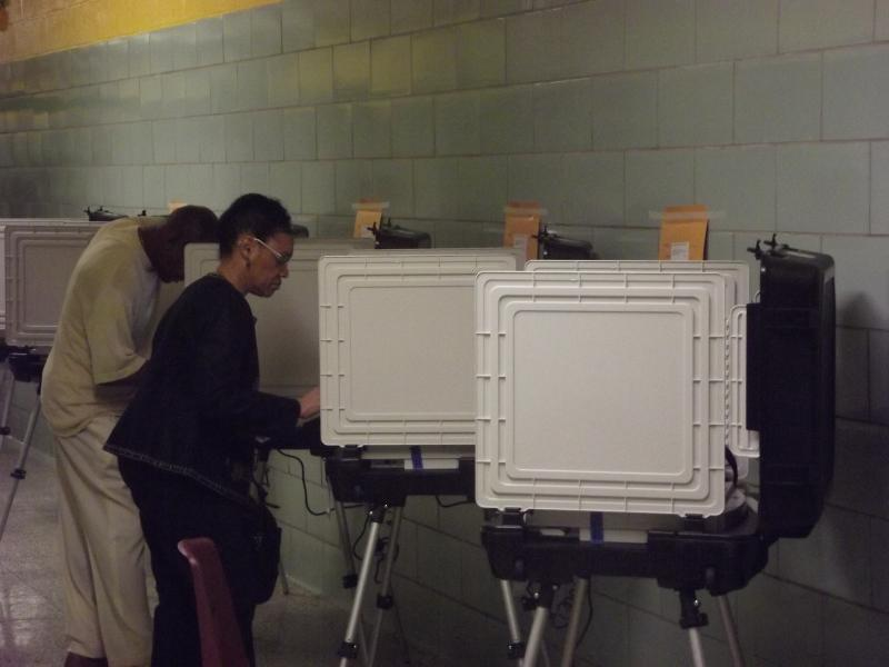 Two of the first voters at the polls at the Baltimore IT Academy.