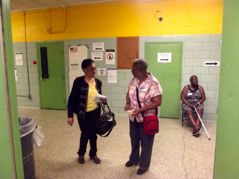 Two area residents share a moment after they cast their votes.