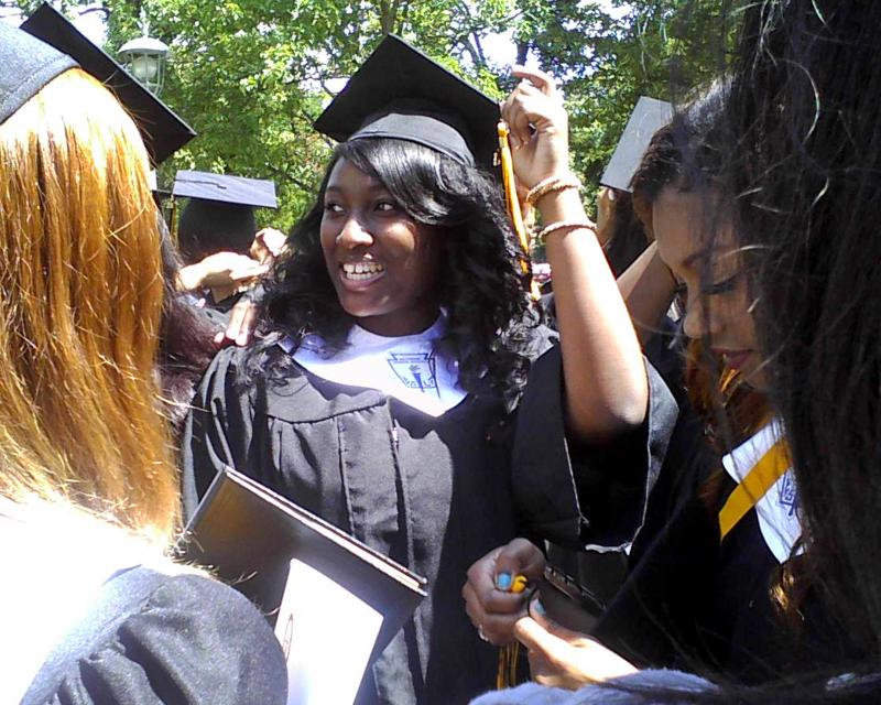 Honor graduate China Blount celebrates with friends after Cristo Rey's graduation Saturday.