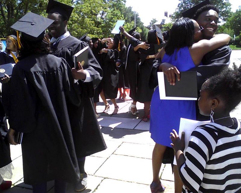 Rachelle Melvin hugs her son, Latroyd Lambert, at Cristo Rey's graduation.