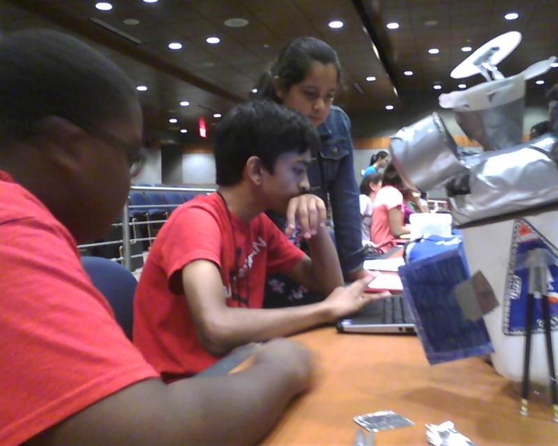 (l-r) Aaron Scott, Panav Gududuri and Ashley Ventura work on a pretend space probe mission.