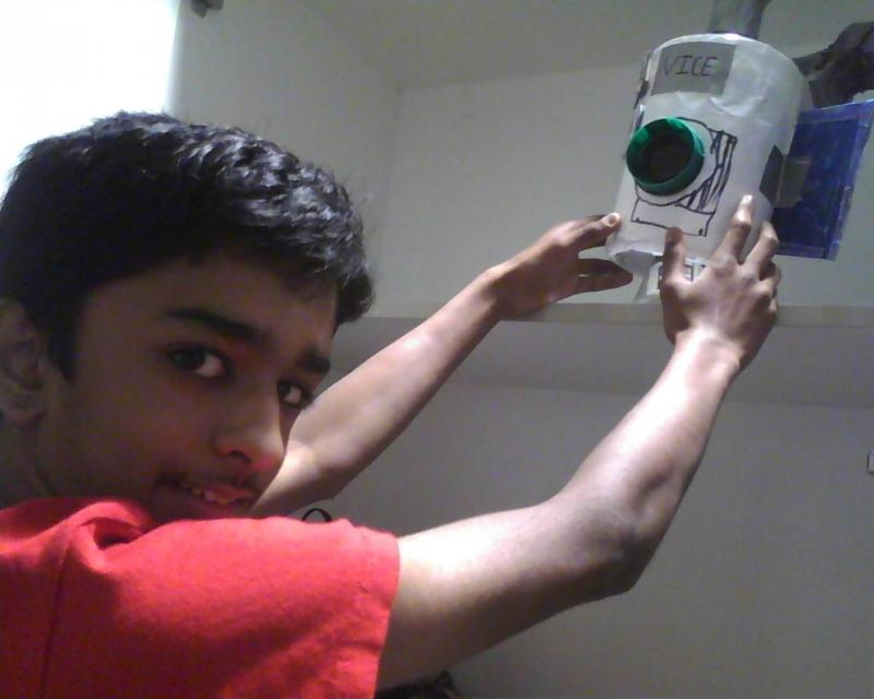 Sixth grader Panav Gududuri places his model space probe on a shelf.