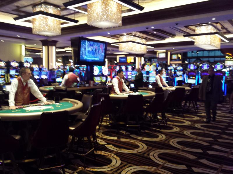 Card dealers waiting for their first customers inside of the casino.