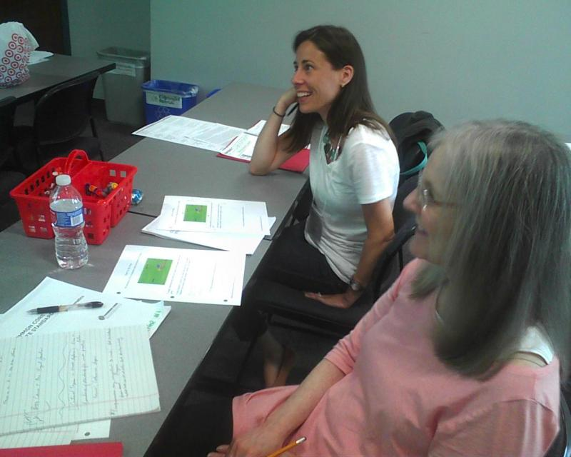 Montgomery County teachers Lindsay Dankmyer, far left, and Paula Zeller work together on math problems during  a Common Core training session at the Universities at Shady Grove in Rockville.