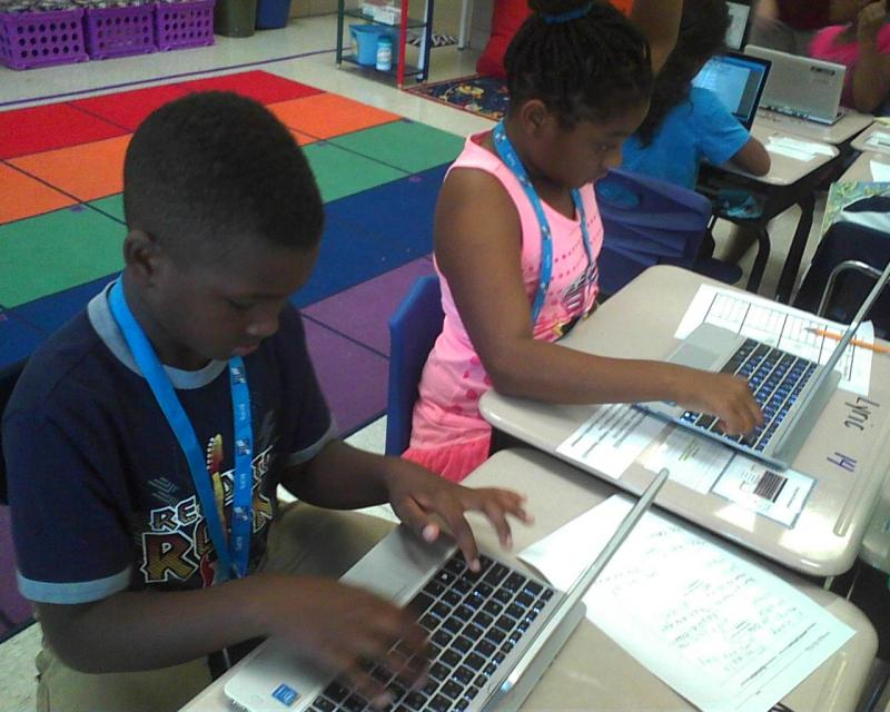 Students at Halstead Academy in Parkville work on laptops during a lesson. Their school is one of ten chosen for the Lighthouse schools program, which focuses on digital education.
