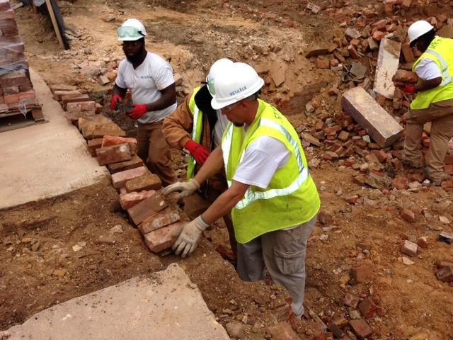 Bricks that are found in the rubble are set aside for processing.