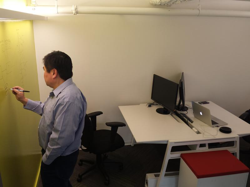 Ed Yoon, chief technology officer for dataFascia, taking advantage of the dry erase walls.