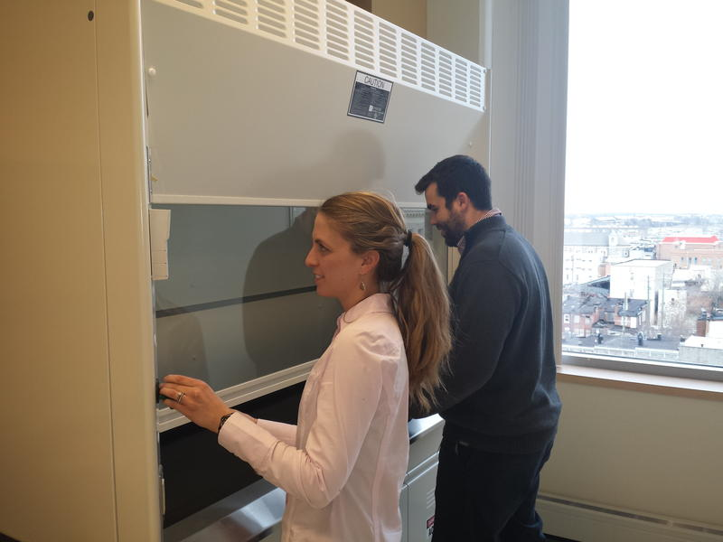 Lauren Dickinson and Matthew Davenport checking out the chemical hood in one of the shared laboratories.