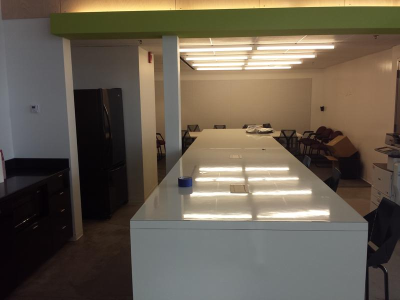 The accelerator also has a common kitchen and a shared conference room (in the background.)  Four additional conference rooms are available by appointment.