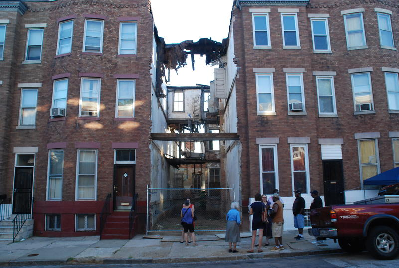 Demolition of a property owned by Scott Wizig in the 1900 block of Boone Street in East Baltimore appears to be threatening the two adjoining houses.