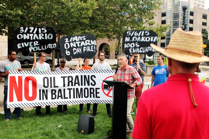 Mike Tidwell of environmental group Chesapeake Climate Action Network calls for an end to trains carrying crude oil through Baltimore at City Hall.