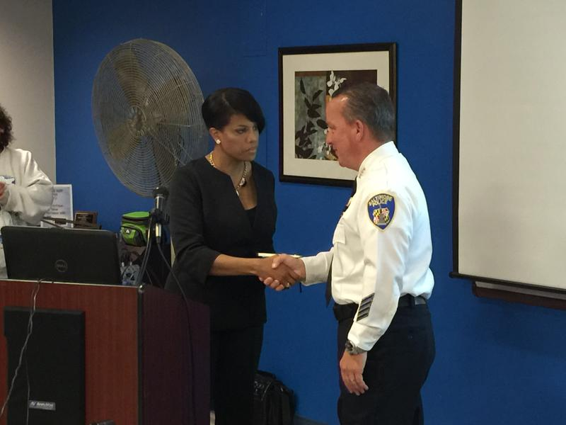 Baltimore Mayor Stephanie Rawlings-Blake shaking the hand of Kevin Davis after she swore him in as the city's 38th police commissioner before a public safety forum in Park Heights Monday.