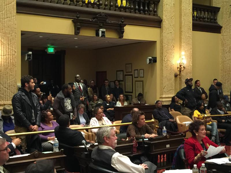 Some protesters interrupting a city council meeting after they voted to confirm Kevin Davis as police commissioner Monday.