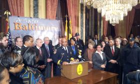 Baltimore Police Commissioner Anthony Batts with Mayor Stephanie Rawlings-Blake surrounded by several police commanders, city agency heads and city residents. They released a strategic plan to fight crime and improve department operations Thursday afternoon.