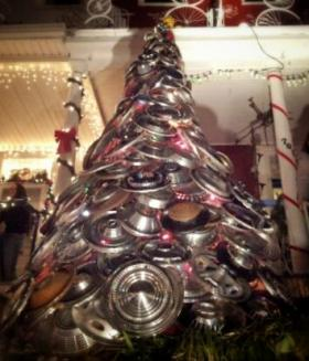 "The Christmas tree made from hubcaps greet visitors to the home of Jim Pollock. Pollock, known as ""The Artist on 34th Street,"" uses his living room as a gallery for his work along with two other artists."