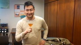 Henry Hong of Waterfront Kitchen tastes his Valentine's Day aphrodisiac, cacao-and-saffron-infused vodka.