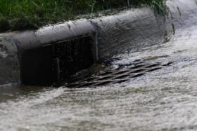 """Opponents of the Maryland stormwater remediation fee have taken to calling it a """"rain tax."""""""