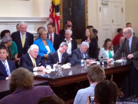 Senate President Mike Miller, Gov. Martin O'Malley, and House Speaker Mike Busch sign laws a day after the 2014 General Assembly session ended.