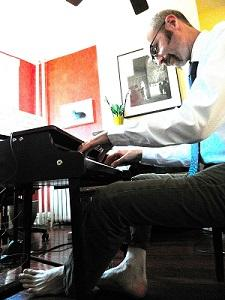 David Smooke at his home, tickling the (mini) ivories
