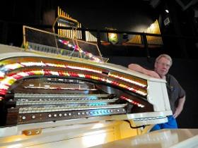 Buddy Boyd, of the Free State Theatre Organ Society, stands behind the Wurlitzer he's been working to restore at Rice Auditorium in Catonsville, MD