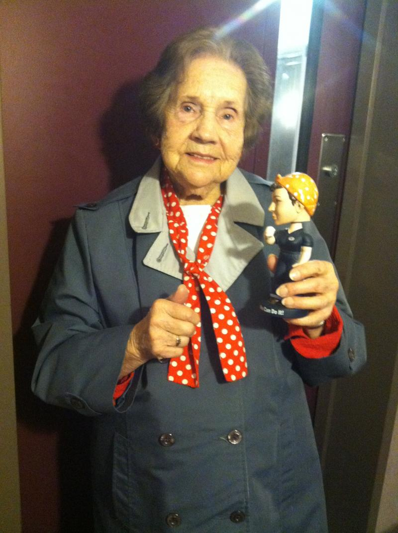 Wilma Foster with a Rosie bobblehead, given to her by WYPR's own  Deborah Davis