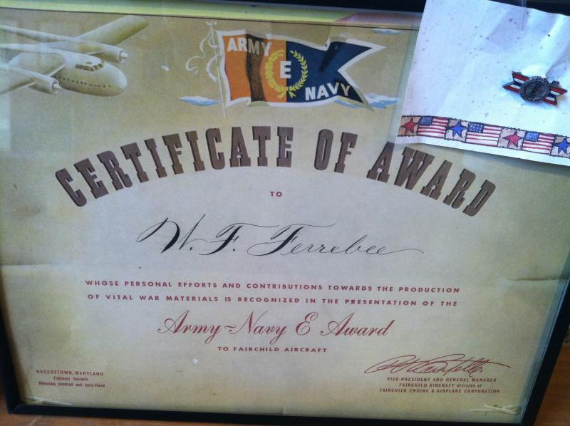 Wilma Foster's certificate and 'Army Navy E Award' (in the upper right hand corner.)